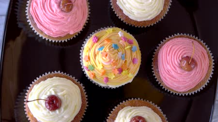 buttercream : Cupcakes with icing. Small appetizing desserts with cherry on top. Pastry and food concept.