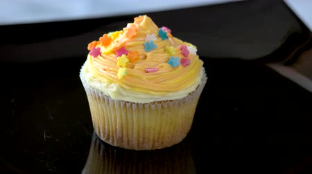 buttercream : Cupcake with delicate cream on plate. Dessert with mascarpone frosting. Impress your friends. Stock Footage