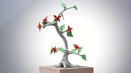 сложить : Paper origami plant. Origami exposition in white background. Стоковые видеозаписи