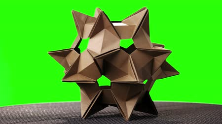 objetos : Yellow origami transforming spiky ball. Green hromakey background for keying. Vídeos