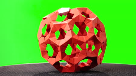 um objeto : Red rotating modular origami. Green hromakey background for keying. Stock Footage