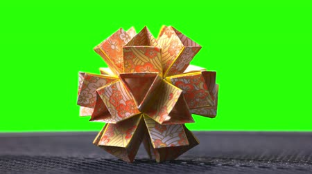 um objeto : Origami Flower Ball Origami. Ball modular origami ball template. Green hromakey background for keying.