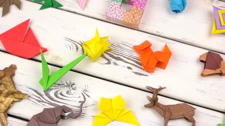 kurbağa : Exposition of origami figures on wood. Flat lay, top view. Stok Video
