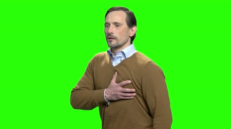 hromakey : Sudden chest pain. Man having a heart attack. Green screen hromakey background for keying.