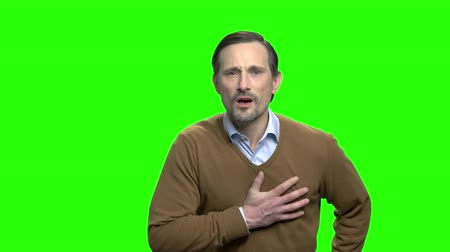 sudden : Man having heart attack. Mature man with chest pain. Green screen hromakey background for keying.