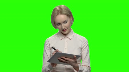 hromakey : Caucasian mature businesswoman with tablet and pen. Green screen hromakey background for keying. Stock Footage
