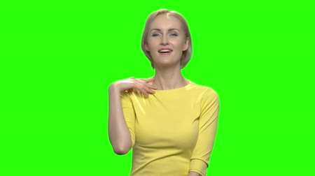 соблазнять : Sexy blond middle aged woman flirting and seducing. Green hromakey background for keying.
