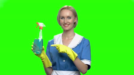 old maid : Cleaner spray advertisement. Woman pointing at clen sprayer. Green hromakey background for keying. Stock Footage