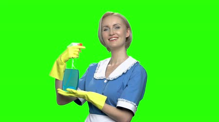 old maid : Woman cleaner with sprayer. Green hromakey background for keying. Stock Footage