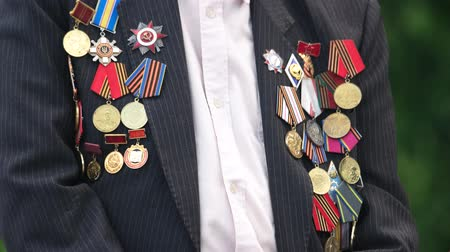 medal : Great world war veteran with medals. Close up. Jacket with awards. Stock Footage