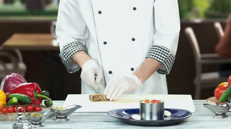 seafood recipe : Chef cutting roasted tuna. Nicoise salad ingredient.