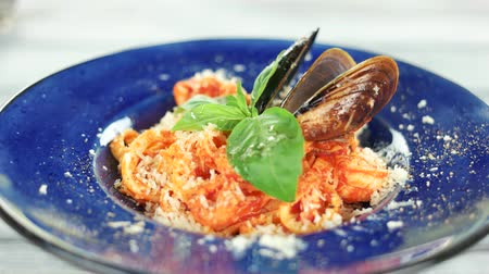 shellfish recipe : Italian pasta close up. Fettuccine, mussels and shrimps.