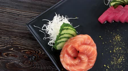 калория : Sashimi, ginger and wasabi. Japanese dish top view.