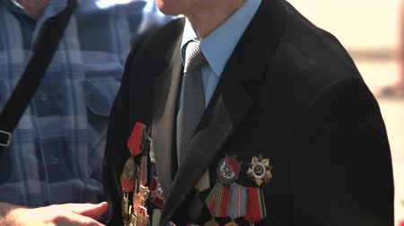 szegfű : 09.05.2018, Ukraine, Kiev. Old senior veteran with awards medals. Victory day celebration, may of 9. Stock mozgókép