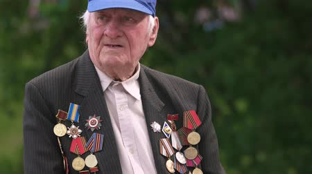 szegfű : 09.05.2018, Ukraine, Kiev. Portrait of senior veteran with medals awards. Old ussr vetetran outdoors, victory day.