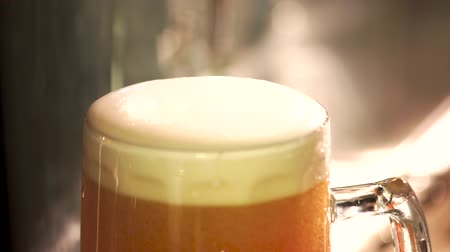 overfill : Lager froth cutting with knife, close up. Foamy head of lager beer cutting.