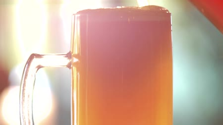 overfill : Full glass of thick orange beer. Glass full of turbid ale, head close up.