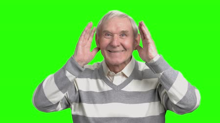 energized : Old man portrait playing with kids. Grandpa put hands up and fooling around, hromakey background.