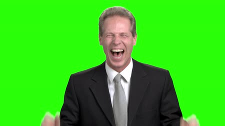energized : Successful corporate male. Amazed excited businessman doesn`t believe his success. Emotional glad laughing with open mouth businessman. Stock Footage