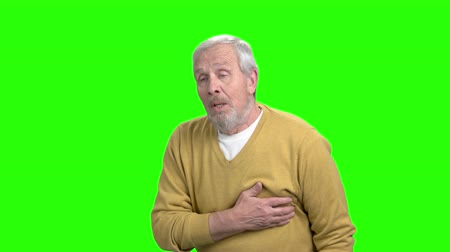 coronary : Mature man with heart attack, green screen. Unhappy man suffering from pain in chest, alpha channel background. Symptoms of infarct.