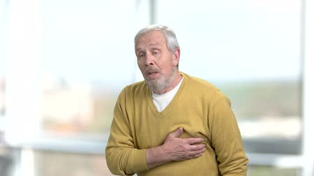infarction : Caucasian aged man suffering from heart-attack. High blood pressure. How to prevent heart attack. Stock Footage