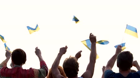 прапорщик : Ukrainian people waving with flags. Group of patriots with Ukrainian flags, back view. National Flag Day celebration.