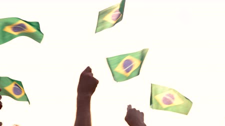 glória : Back view people raising Brazilian flags. Patriotic Brazilian family waving with flags outdoors.
