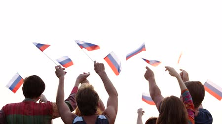 brasão : Group of people waving Russian flags. People hands raised National flag of Russia outdoors.