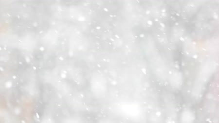 Close up of falling snowflakes. Abstract winter background. Winter holiday wallpaper.