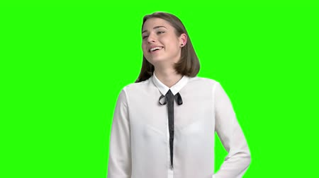 Young woman laughing hard. Green hromakey background for keying. Slow motion.