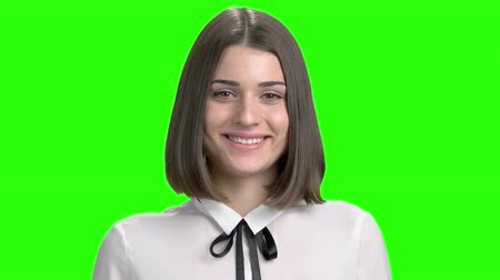 słoneczko : Facial expressions of young brunette girl fall in love. Adorable brown-eyed woman portrait. Green screen hromakey background for keying. Wideo