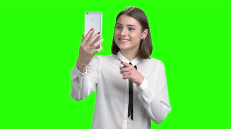 köszönt : Online video conversation on the phone using web cam. Green screen hromakey background for keying.