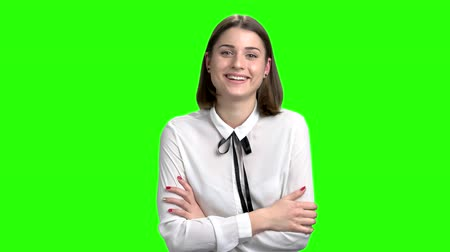 Portrait of cute young girl greeting. Green screen hromakey background for keying.