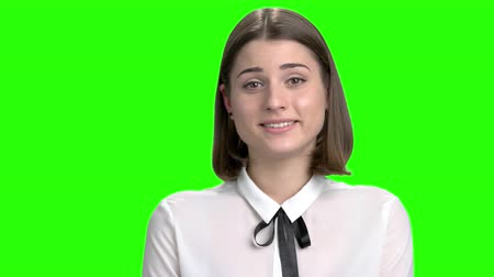Portrait of young sexy brunette girl likes you and flirting. Sweet lovely smiling woman sympathizing. Green screen hromakey background for keying. Wideo