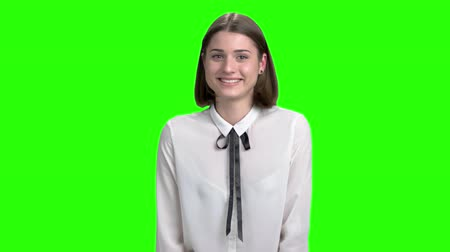 Young sweet woman laughing out loud. Portrait of emotional brunette business woman. Green screen hromakey background for keying.