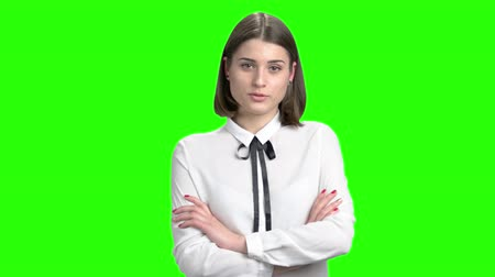 neutro : Serious business woman gravely talking and scolding. Female manager isnt satisfied with your job. Green screen hromakey background for keying.
