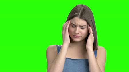 хмурый : Close up portrait of woman having head pain. Green screen hromakey background for keying. Стоковые видеозаписи