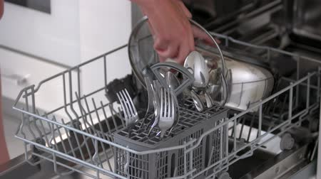 Open dishwasher with clean cutlery. Female hands taking out dishes from dishwasher machine. Home equipment for cleaning. Wideo