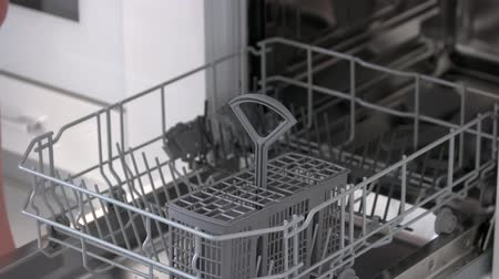 motivo : Woman using dishwasher at home. Modern appliance for dishes cleaning. Reasons to buy dishwasher. Stock Footage