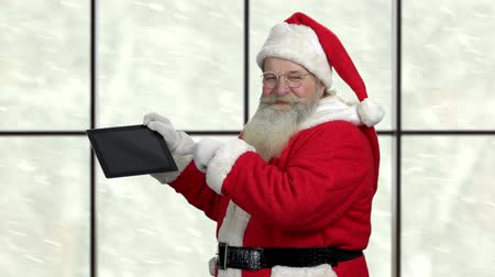 Happy Santa Claus presents pc tablet. New Year gift ideas. Great Christmas offer.