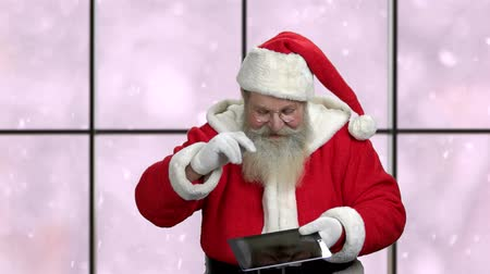 grandfather : Santa with digital tablet showing ok sign. Christmas season deals. New Year discount offer.