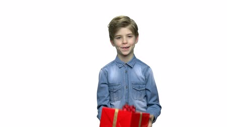 omini : Portrait of boy with Birthday gift. Lovely little kid playing with present box. People and holiday celebration concept.
