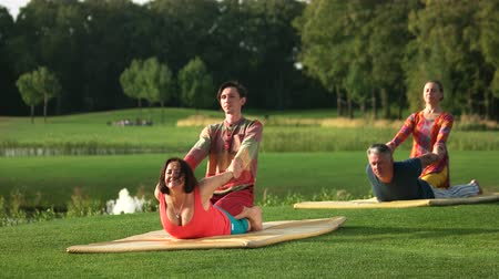 cobra : Thai massage in cobra position. Man and woman doing stretching exercise with yoga trainers outdoor. Opens and stretches neck. Best type of massage therapy.