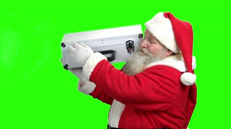 santaclaus : Senior Santa showing case full of money. Happy authentic Santa Claus on Alpha Channel background. Merry Christmas and happy New Year.