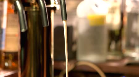 karczma : Beer tap beginning to flow. Detail of a beer tap starting to pour.