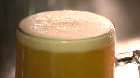 overfill : Beer foam scraper cutting, slow motion. Beer cutting macro close up, slow-mo.