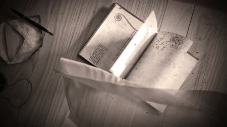 szürkeárnyalatos : Black and white stylize Animation of a book opening, with winding leafs and curtains conceptual background Stock mozgókép