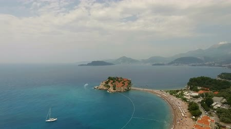 saint stephen : Aerial view of yacht niar small islet and resort in Montenegro Stock Footage