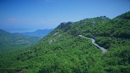 navíjení : Aerial view of a curved winding road with cars passing. Mountain road