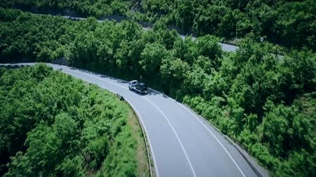 serpentine : Aerial view of a curved winding road with cars passing. Mountain road